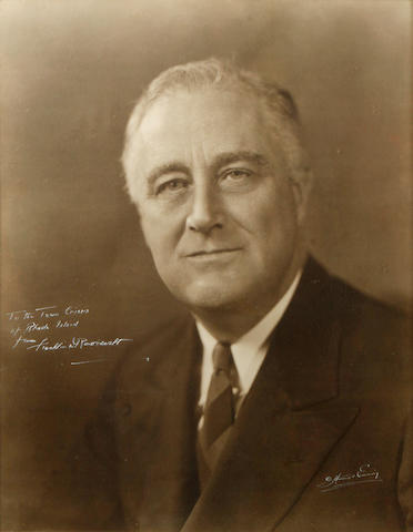 "ROOSEVELT, FRANKLIN DELANO.  1882-1945. Photograph Signed (""Franklin Delano Roosevelt"") and Inscribed, 18 x 23 inch silver print portrait by Harris Ewing with photographer's signature at lower right corner,"