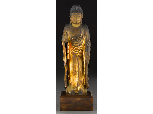 A gilt laquer wood statue of a Buddha Edo period