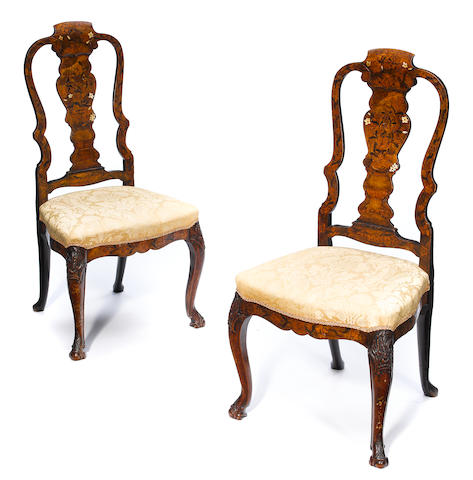 A pair of George II marquetry inlaid walnut side chairs <BR />possibly Dutch <BR />mid 18th century