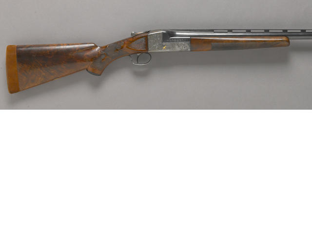 A 12 gauge Ithaca Grade 5E Knick single barrel trap shotgun