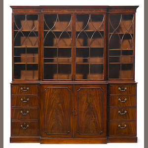 A George III mahogany breakfront bookcase . fourth quarter 18th century