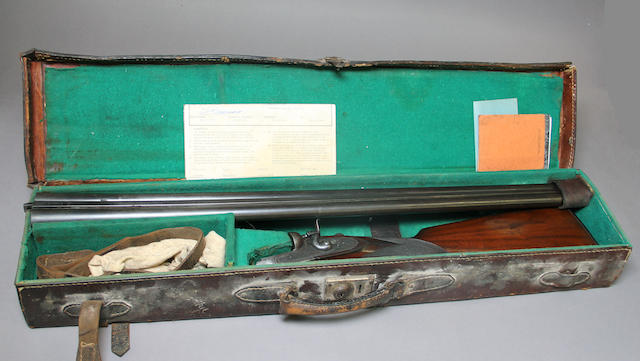 A cased 12 gauge English hammer shotgun by Fredrick Williams
