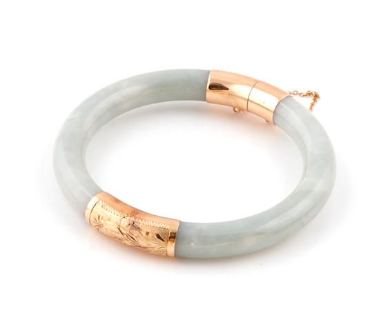 A green-blue jade and 14k gold bangle