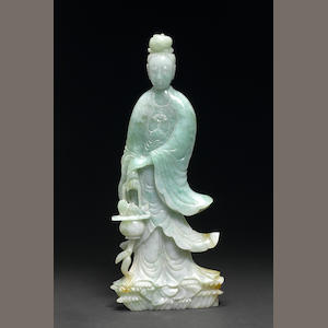 A mottled green jadeite figure of Guanyin Late Qing/Republic period