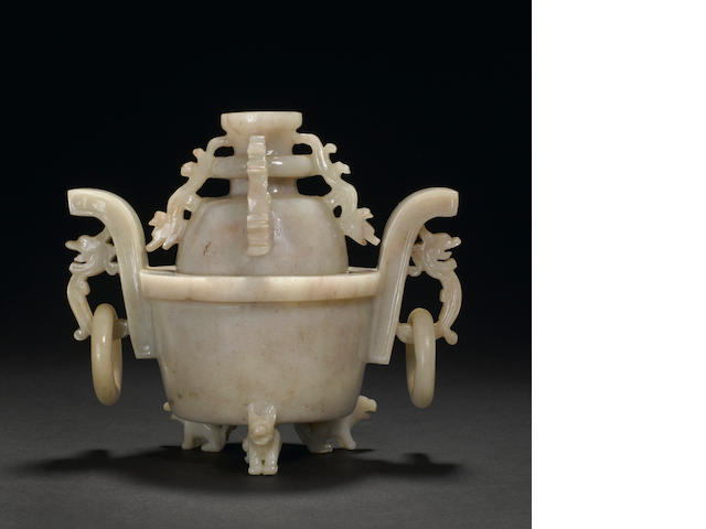 A carved hardstone lidded tripod censer