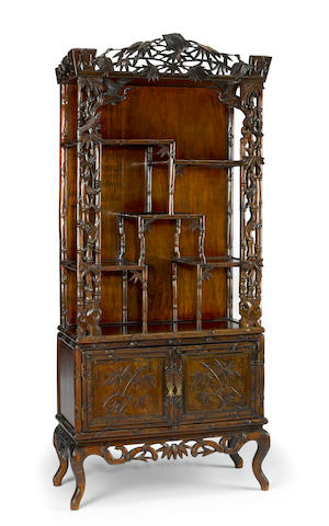 A carved hardwood display cabinet 20th century