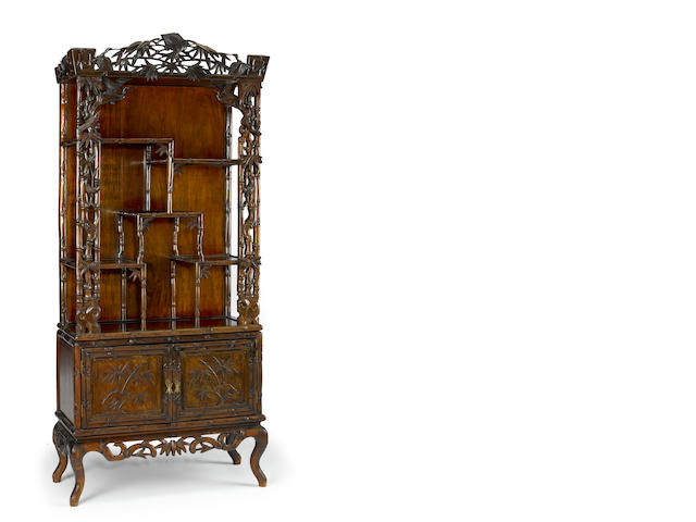 A carved hardwood display cabinet, 19th/20th century