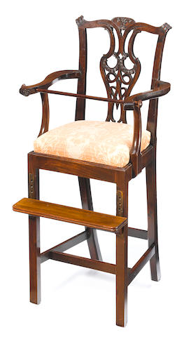 A George III style carved mahogany high chair <BR />19th century
