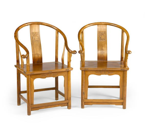 A pair of mixed wood horseshoe back chairs late Qing/Republic period
