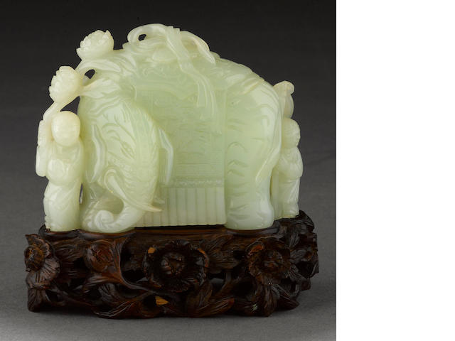 A pale green jade carving of an elephant and figural group Qing dynasty