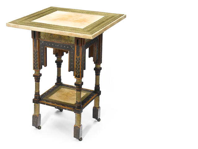 A Carlo Bugatti ebonized wood, pewter and copper inlaid, hammered brass overlaid and parchment side table  circa 1900