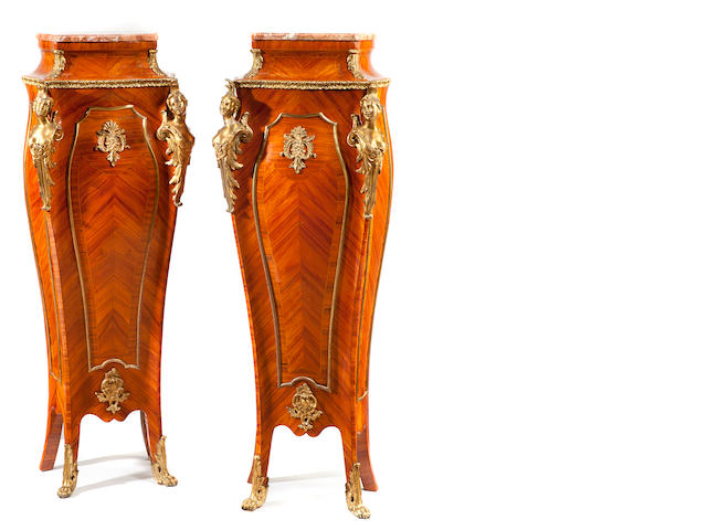 A pair of Louis XV style gilt bronze mounted inlaid walnut pedestals