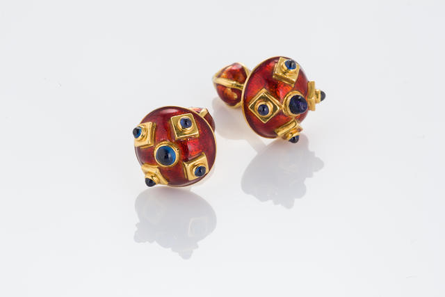 A pair of eighteen karat gold, red enamel and sapphire cufflinks, English,