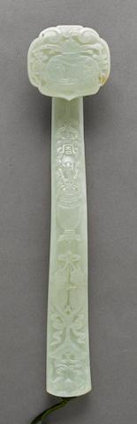 A pale green jade scepter