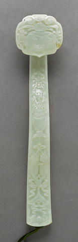 A pale green jade scepter