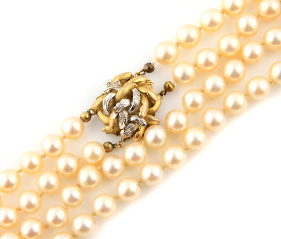 A double strand cultured pearl necklace with a gold and diamond clasp