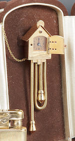 A ruby and eighteen karat gold cuckoo clock lapel watch, Marley & Co., Paris