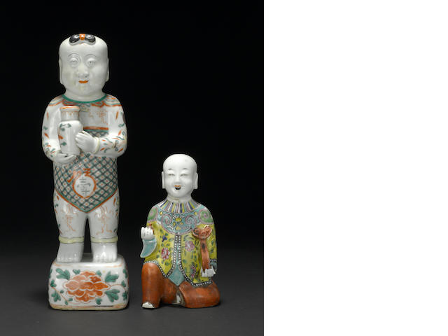 Two polychrome enameled porcelain figures of young boys Kangxi period