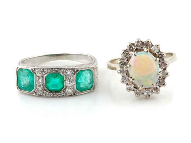 A set of two opal, diamond, emerald and 14k white gold rings