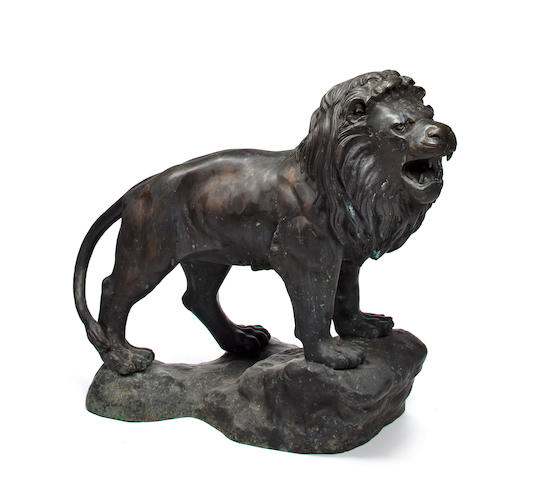 A large cast bronze lion sculpture  37 x 44 in. (93.9 x 111.7 cm.)