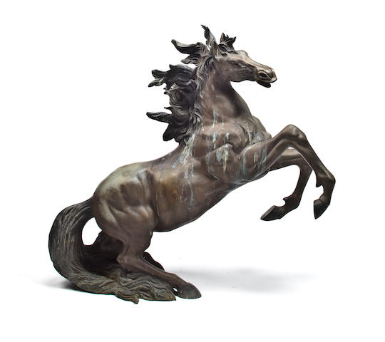 A cast bronze sculpture of a rearing horse 34 x 38 in. (86.3 x 96.5 cm.)