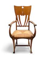 A rare Gustave Serrurier Bovy oak and rush armchair circa 1898