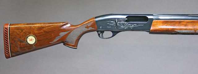 A 12 gauge Browning Model 1100 shotgun