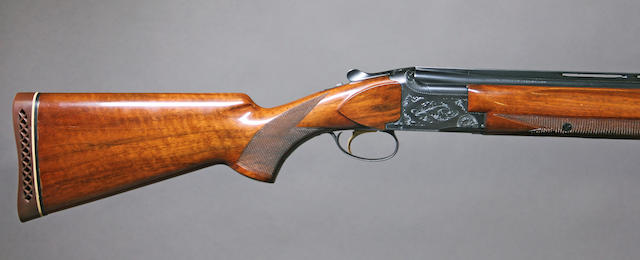 A 12 gauge Browning Lightning superposed shotgun