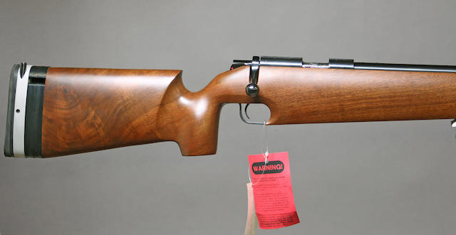 A boxed .22 caliber Kimber Model 82 All American Match bolt action target rifle