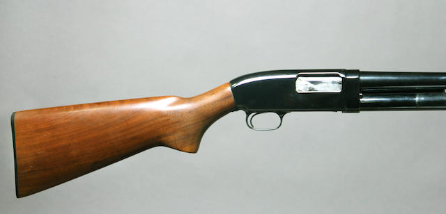 A 12 gauge Winchester Model 25 slide action shotgun