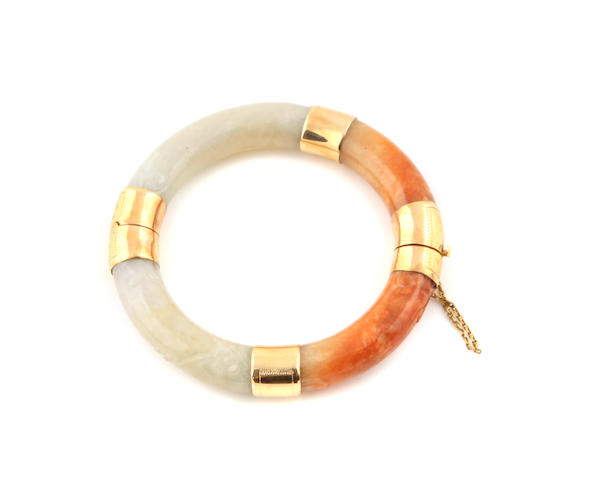 A multi-colored jade and 14k gold bangle