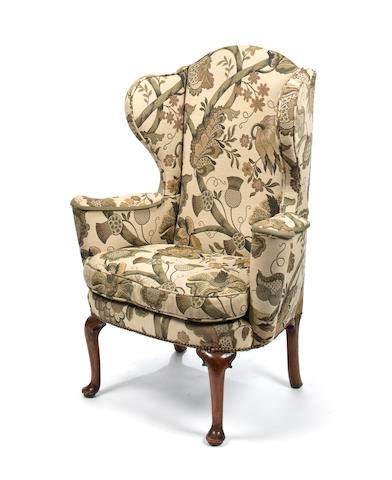 A George I walnut upholstered wing chair<BR />second quarter 18th century