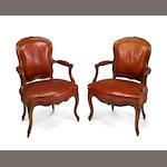 A pair of Louis XV style beechwood fauteuils<BR />20th century