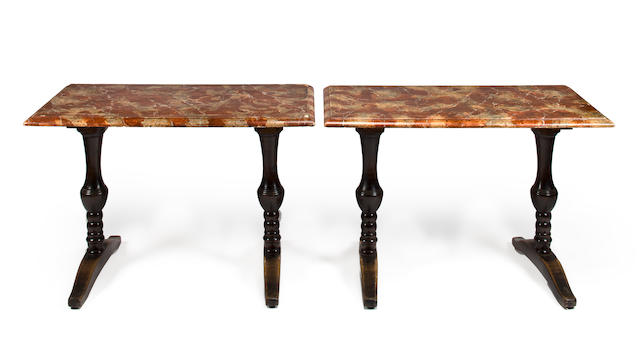 A pair of Continental mixed wood console tables with faux marble tops