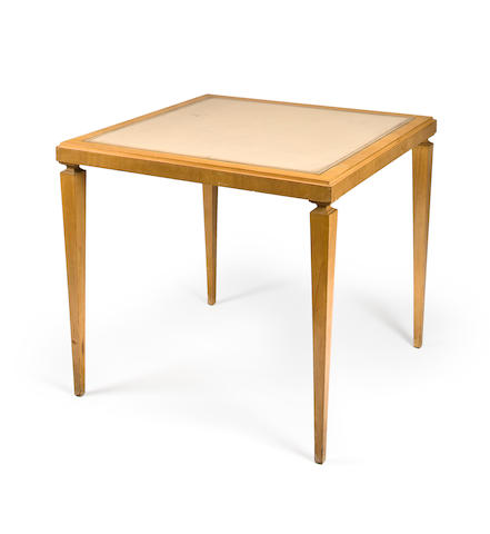 a blonde fruitwood card table