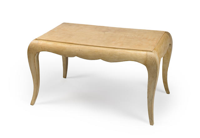 An Art Deco vellum covered low table