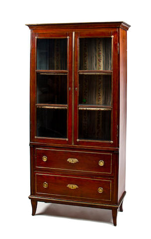 A French late Restauration gilt bronze mounted mahogany bookcase
