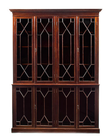 a George III style mahogany breakfront bookcase, 20th c.