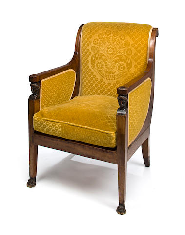 An Empire carved mahogany bergere