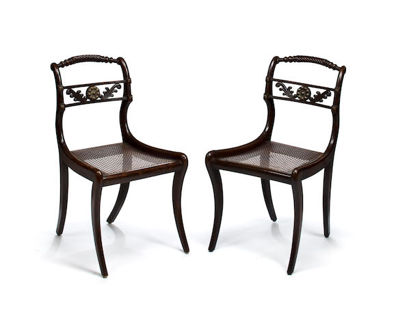 A pair of Regency gilt metal mounted faux rosewood side chairs<BR />early 19th century