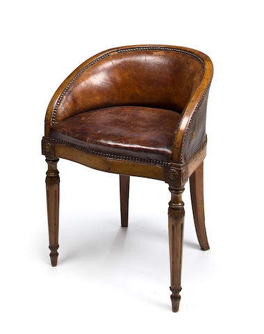 A Neoclassical style Italian leather upholstered desk chair<BR />late 19th century