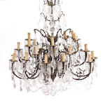 A Louis XV style gilt bronze and glass twenty four light chandelier