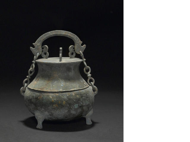 A cast bronze archaic lidded vessel Han dynasty