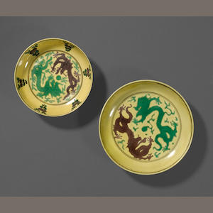 Two three-color enameled porcelain saucers with dragon dishes Kangxi marks and period