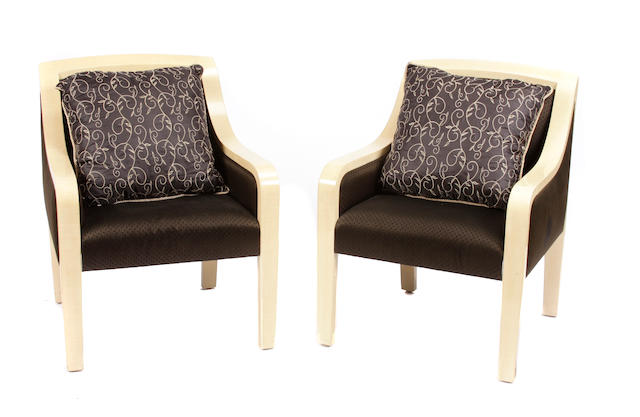 A pair of Contemporary upholstered blond wood armchairs