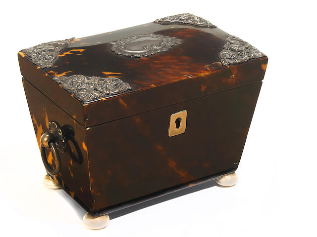 A Regency tortoiseshell and later silver mounted tea caddy <BR />early 19th century