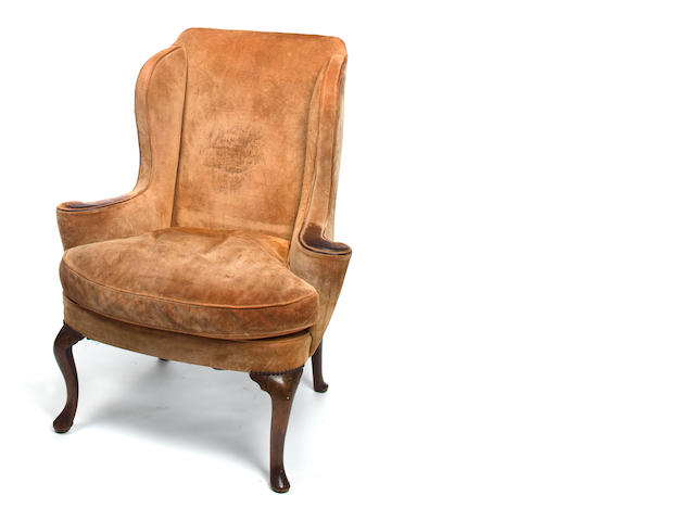 A George I/II walnut framed wing armchair<BR />first half 18th century
