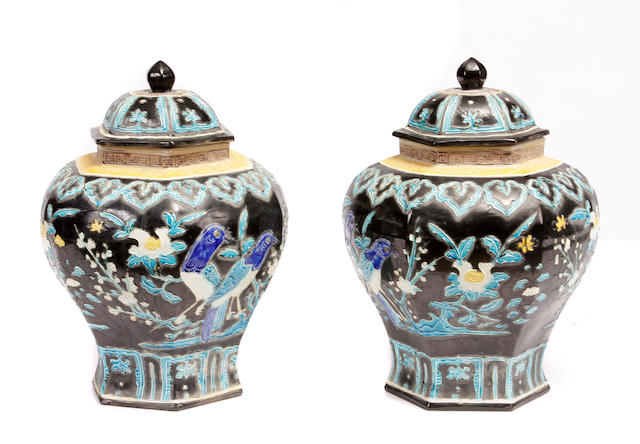 A pair of Chinese polychrome decorated porcelain vases