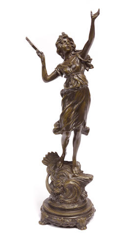 An Art Nouveau style patinated bronze figure of a maiden