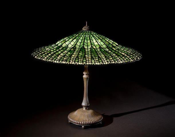 A Tiffany Studios Farvrile glass and patinated bronze Lotus table lamp circa 1910